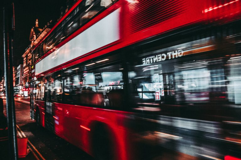 time lapse of red bus